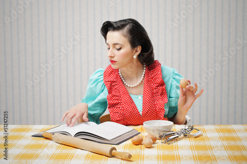 Girl reads a cookbook