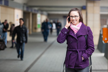 Young Woman Talking on Mobile at Train Station