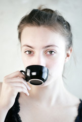 Woman with black Cup of Coffee