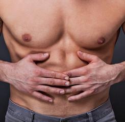 Trainierter Bauch hat Schmerzen