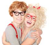 Happy nerdy couple embracing