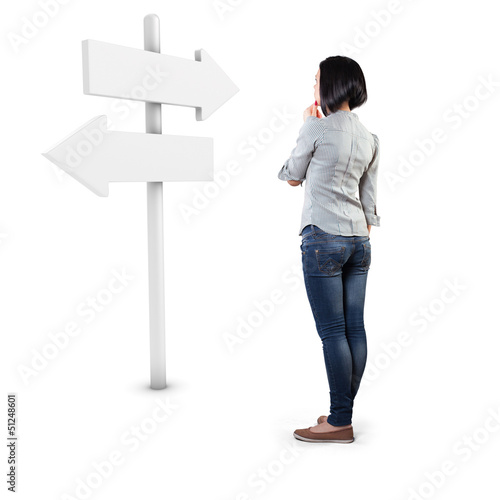 Girl before a roadsign