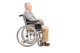 A disabled senior gentleman posing in a wheelchair