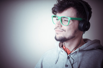 boy with sweatshirt and headphones