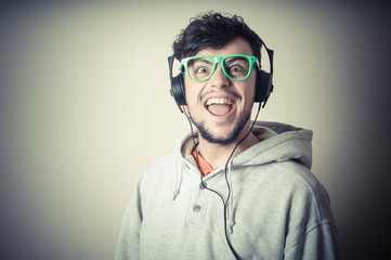 boy with sweatshirt and headphones