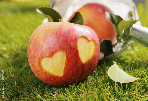 Fresh apple with incised hearts