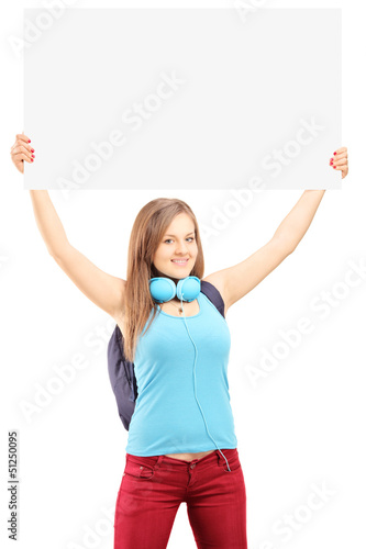 Beautiful young female with school backpack holding a white pane