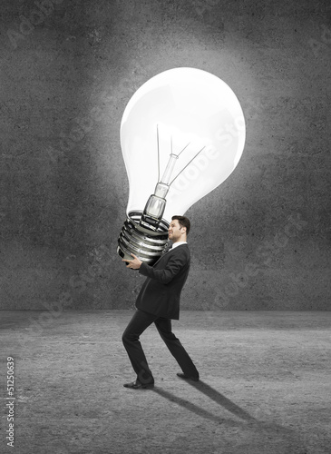 man holding lamp