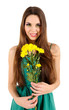 Young beautiful girl in green dress with nice flowers in her