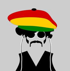 man wearing rastafarian hat and earphones