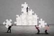 Business teamwork building puzzle