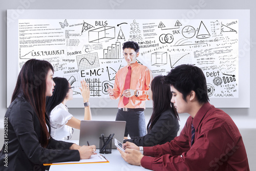 Business presentation on whiteboard