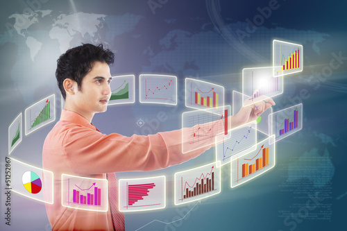 Businessman choose graph on touchscreen