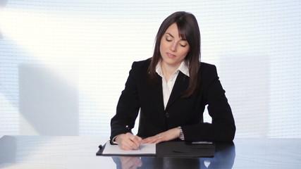Female executive at desk.