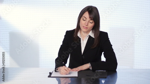 Female executive at desk.