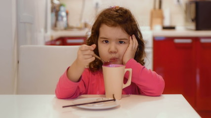 Little girl is not happy with the breakfast