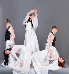 Actors in the wedding dress posing.