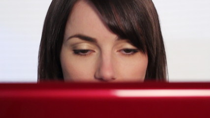 Woman at computer nodding off.
