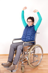 Woman in wheelchair with stretching exercises