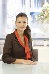 Portrait of young businesswoman sitting at desk