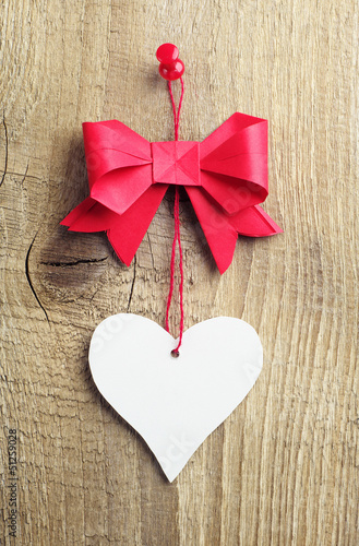 Red bow with a heart made of paper