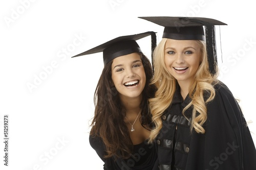 Happy graduates in graduation cap