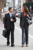 Businessman And Businesswoman In Street With Takeaway Coffee