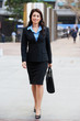 Portrait Of Businesswoman Walking Along Street