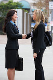 Two Businesswomen Shaking Hands Outside Office