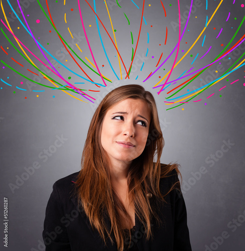 Young girl thinking with colorful abstract lines overhead