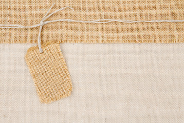Sackcloth tag pricing over burlap fabric texture