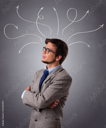 Young man thinking with arrows overhead
