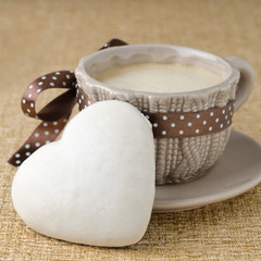 cake with icing in the form of heart and a cup of coffee