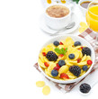 Cornflakes, fresh berries, cup of cappuccino and orange juice
