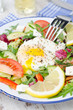 Vegetable salad with poached egg on a plate, vertical
