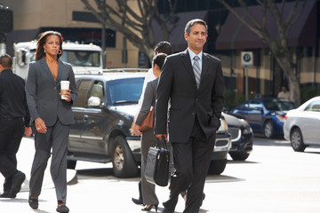 Group Of Businesspeople Crossing Street