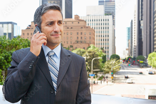 Businessman Outside Office On Mobile Phone