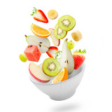 Light salad with flying fresh fruits