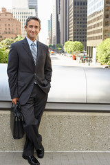 Portrait Of Businessman Standing Outside Office