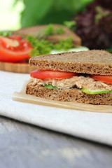Sandwich with tuna fish, fresh tomato slices