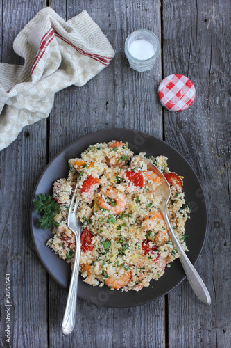 Portion of cauliflower couscous salad with shrimps
