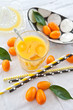 canvas print picture - Fresh juice from oranges and kumquats