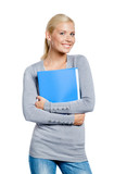 Girl in grey sweater hands folder with documents