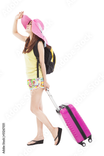 young woman in summer outfit  with travel case