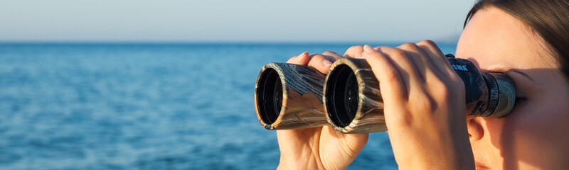 a woman is looking to the binocular