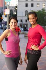 Portrait Of Two Female Runners On Urban Street