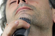 close up of man with electric razor