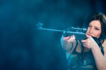 Beautiful woman holding weapon
