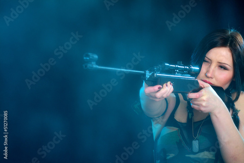 Beautiful woman holding weapon