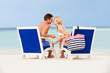 Couple On Beach Relaxing In Chairs
